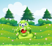 A scary three-eyed green monster at the hilltop Stock Photo
