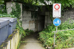 Scary underpass with street sign. And dark entrance Stock Photo