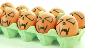 Scary vampire crazy eggs on white background. Dolly-shot close up stock video footage