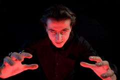 Scary vampire stretching his hands. To catch a victim, isolated on black background Stock Photography