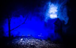 Scary view of zombies at cemetery dead tree, moon, church and spooky cloudy sky with fog, Horror Halloween concept Stock Photography