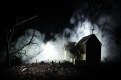 Scary view of zombies at cemetery dead tree, moon, church and spooky cloudy sky with fog, Horror Halloween concept Stock Photos