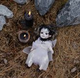 Scary voodoo doll with black candles. Mystic background with ritual esoteric objects, occult and halloween scary concept royalty free stock photo