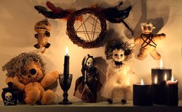 Scary voodoo dolls, pentagram and black candles royalty free stock image