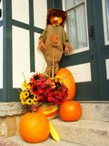 Scary Welcome. Scarecrow and pumpkins at the door Stock Photography