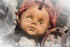 Scary white doll face. Very old and broken Stock Images