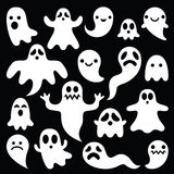 Scary white ghosts design on black background - Halloween celebration Royalty Free Stock Images
