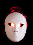 Scary white mask with red eyes Royalty Free Stock Photography