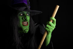 Scary witch flying on her broomstick.. Royalty Free Stock Images