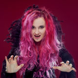 Scary witch with red hair performs magic. Halloween. Royalty Free Stock Photography