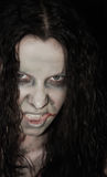 Scary woman. Close up portrait of scary woman Stock Image