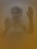 Scary Woman behind a glass door. Horror Scene of a Scary Woman behind a glass door Royalty Free Stock Image