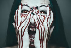 Scary woman in blood Royalty Free Stock Photo