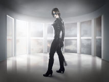 Scary.woman dressed in latex, whip and black wings. Pretty Stock Image