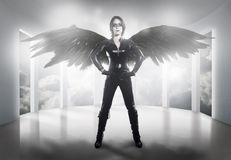 Scary.woman dressed in latex, whip and black wings royalty free stock photo