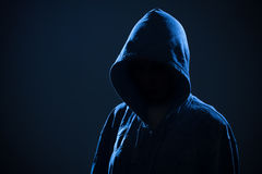 Scary woman with hood in darkness Royalty Free Stock Image