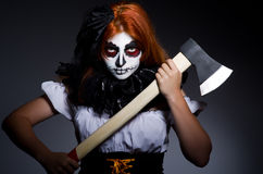 Scary woman with metal axe. In halloween concept Stock Photo