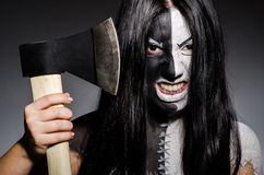 Scary woman with metal axe. In halloween concept Royalty Free Stock Photo