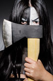 Scary woman with metal axe. In halloween concept Stock Image