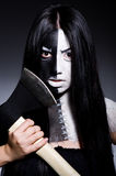 Scary woman with metal axe. In halloween concept Stock Images