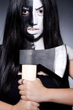 Scary woman with metal. Axe in halloween concept Royalty Free Stock Photos