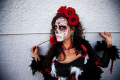 Scary woman with Rose in hand Royalty Free Stock Photography