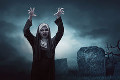 Scary young asian nun woman in graveyard Stock Photography