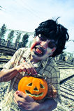 Scary zombie with a carved pumpkin, with a filter effect Stock Images