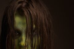 Scary zombie face. Close up portrait of a scary zombie face royalty free stock photo