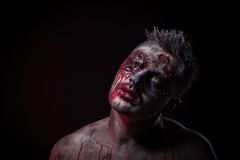 The scary zombie is lying in the studio Royalty Free Stock Images