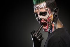 Scary zombie makeup on mans face isolated on black background. Face art, man with monster face royalty free stock photos