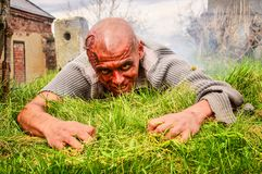 Scary zombie man. Zombies can climb out of the grave Stock Photography