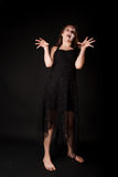Scary zombie woman. In black dress Stock Photography