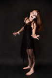 Scary zombie woman. In black dress Stock Images