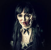 Scary zombie woman with black eyes stock image
