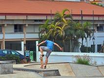 Skateboarder during an exercise outdoor stock photo