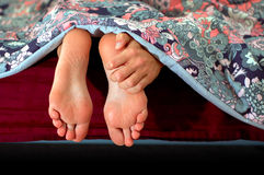 Scatching feet. Funny picture of someone with long arms who can scratch her feet Stock Photos