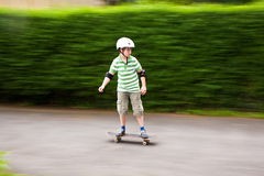 Scateboarding Boy with helmet in motion Stock Photos