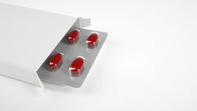 Scatola in bianco della pillola su fondo bianco Fotografia Stock