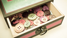 Scatola d'annata di bottoni Immagini Stock