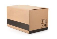 Scatola di cartone con i simboli dell'imballaggio Fotografia Stock Libera da Diritti