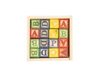 Scatola di legno di Toy Cubes With Letters On Fotografia Stock
