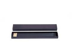 Scatola nera con le matite nere Fotografie Stock