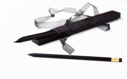 Scatola nera con le matite nere Fotografie Stock Libere da Diritti