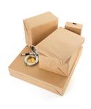 Scatole dei pacchetti su bianco Fotografie Stock