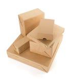 Scatole dei pacchetti su bianco Immagini Stock Libere da Diritti