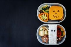 Scatole di pranzo per i bambini sotto forma di mostri Fotografia Stock Libera da Diritti