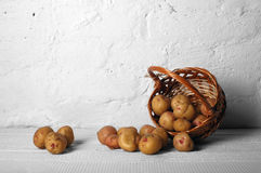 Scatter basket with potatoes Royalty Free Stock Photo