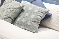 Scatter cushion on the bed in bedroom. Pillow stock image