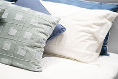 Scatter cushion on the bed in bedroom. Pillow stock images